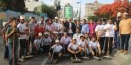 """بالصور..""""فتح رفح"""" تنظم يوم تطوعي لتنظيف وتزين شوارع المحافظة في ذكرى أبو علي شاهين"""