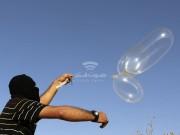 مسؤول عسكري إسرائيلي يهدد : سنرد بقوة إن لم يتوقف إطلاق البالونات من غزة