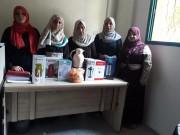 """بالصور.. """"إصلاحي فتح"""" يوزع أجهزة كهربائية على الأسر الفقيرة شمال غزة"""