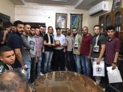 """بالصور.. الشبيبة الفتحاوية توزع """"القرطاسية"""" على طلبة المدارس في شمال غزة"""