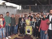 بالصور|| تيار الإصلاح يقدم مساعدة عاجلة لعائلة السواركة في دير البلح