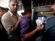 مجهولون يطلقون النار على صراف آلي ويخطون شعارات تضامنية مع الأسرى في رام الله- صور